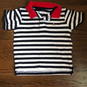 Boys blue and white striped polo with red collar